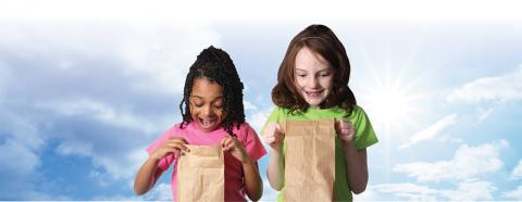 elementary school age girls with lunch bags