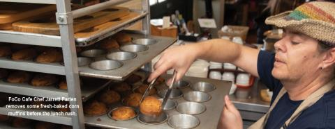 FoCo Cafe Chef Jarrett Parten removes muffins