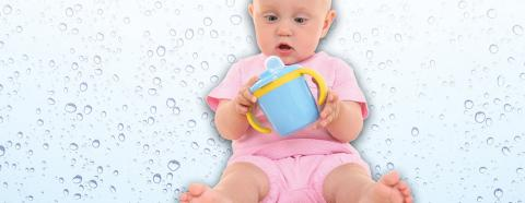baby looking at sippy cup