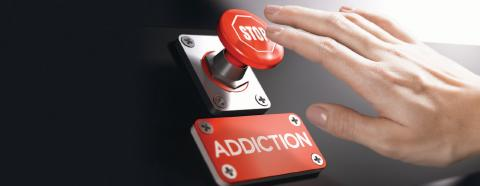 hand pushing stop addiction button