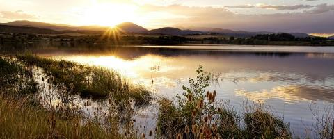 Sun setting over a rural scene