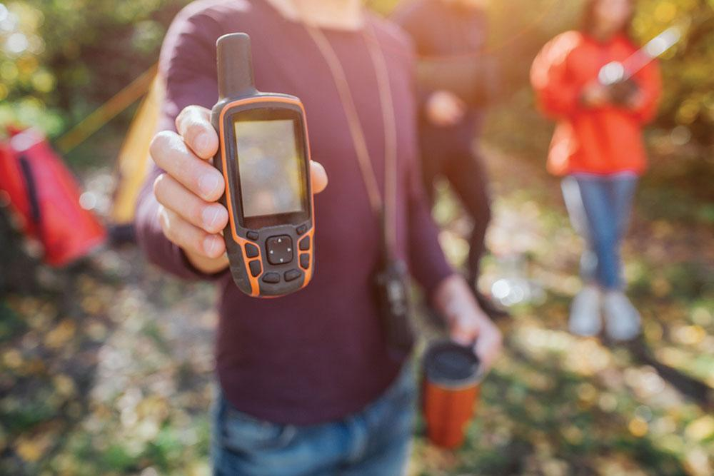 satellite phone in hand